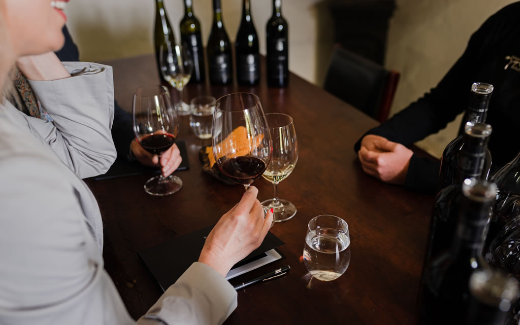 Two visitors enjoy tasting wine as part of the Henschke Mount Edelstone Experience