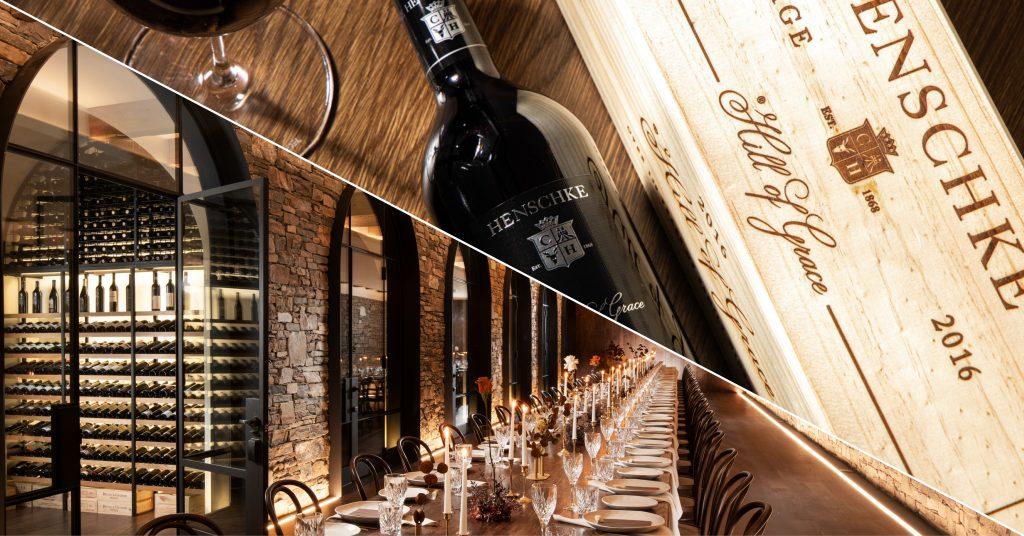 A bottle of Henschke wine alongside the cellar at Kingsford The Barossa