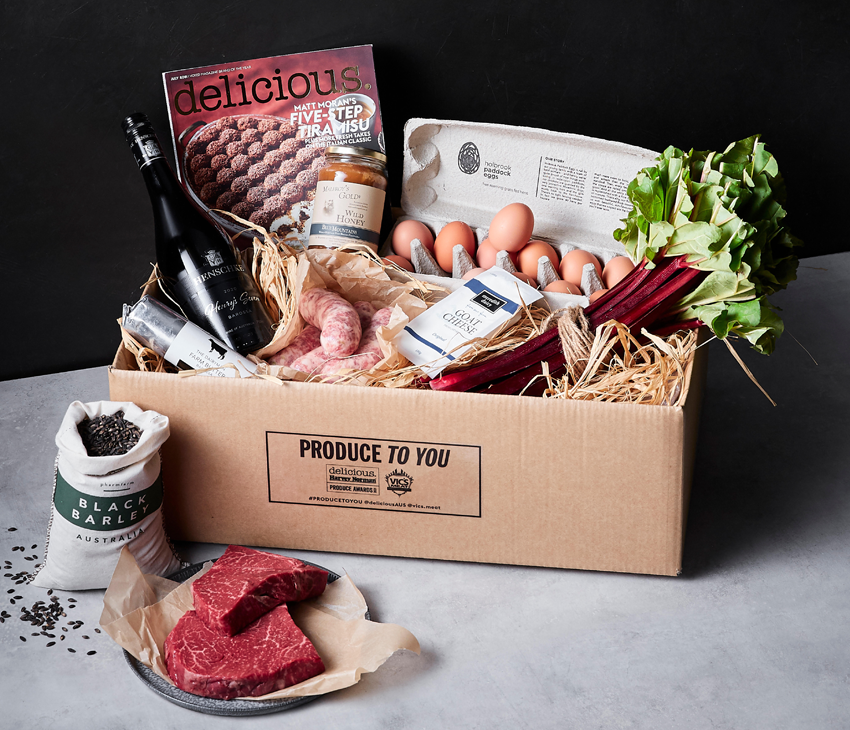 Box of local produce featuring Henschke wine