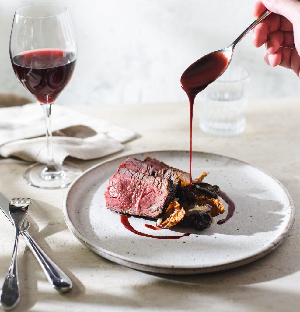 A plate of sirloin steak with jerusalem artichoke puree and chips